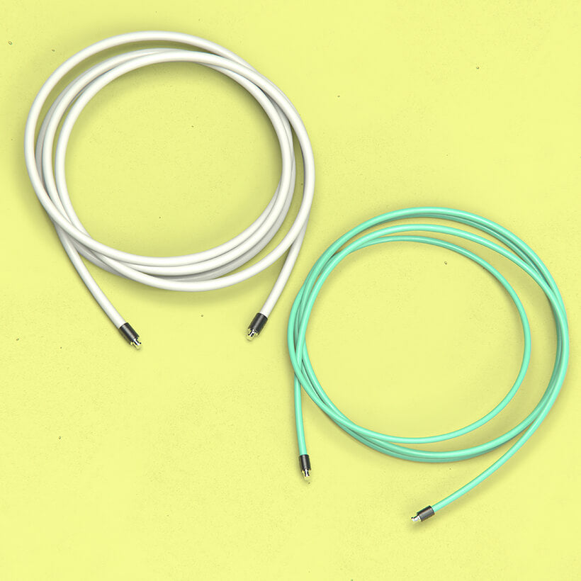 A coiled 1/2 LB jump rope beside a coiled 1/4 LB jump rope