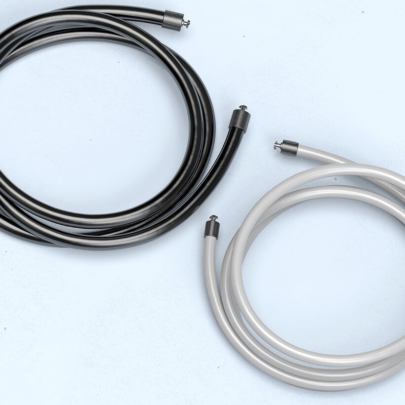 A coiled 2 LB jump rope beside a coiled 1 LB jump rope