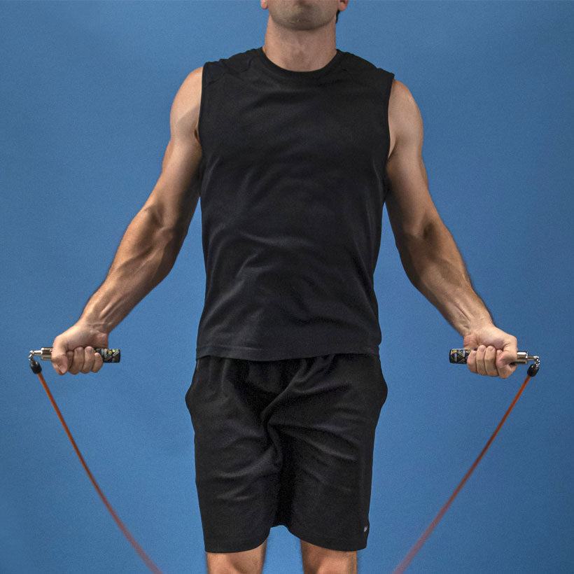 Man jumping with a 1 LB Speed Pro rope with Speed Pro LE handles