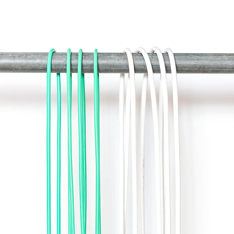 A close-up view of 1/4 LB and 1/2 LB ropes hanging from a rod