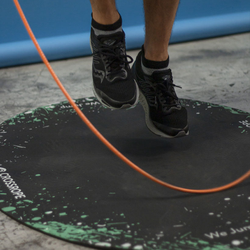 A close up view of a 1 LB jump rope being used
