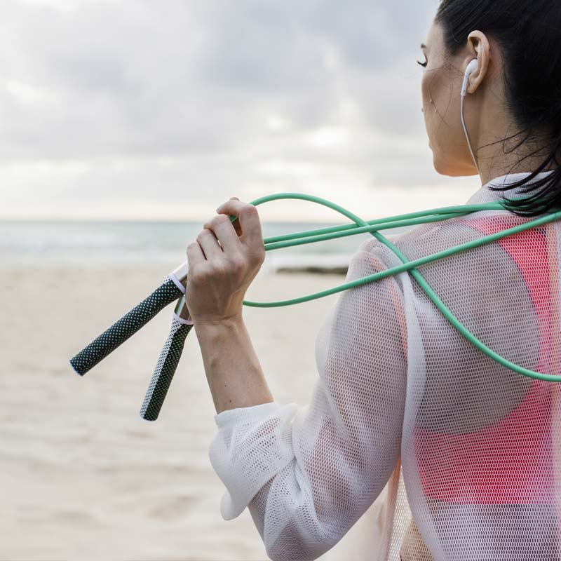 Woman holding Slim Handles with 1/4 LB Jump Rope