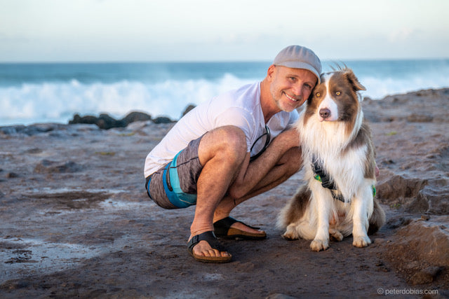 Dr. Peter Dobias and Pax on the beach