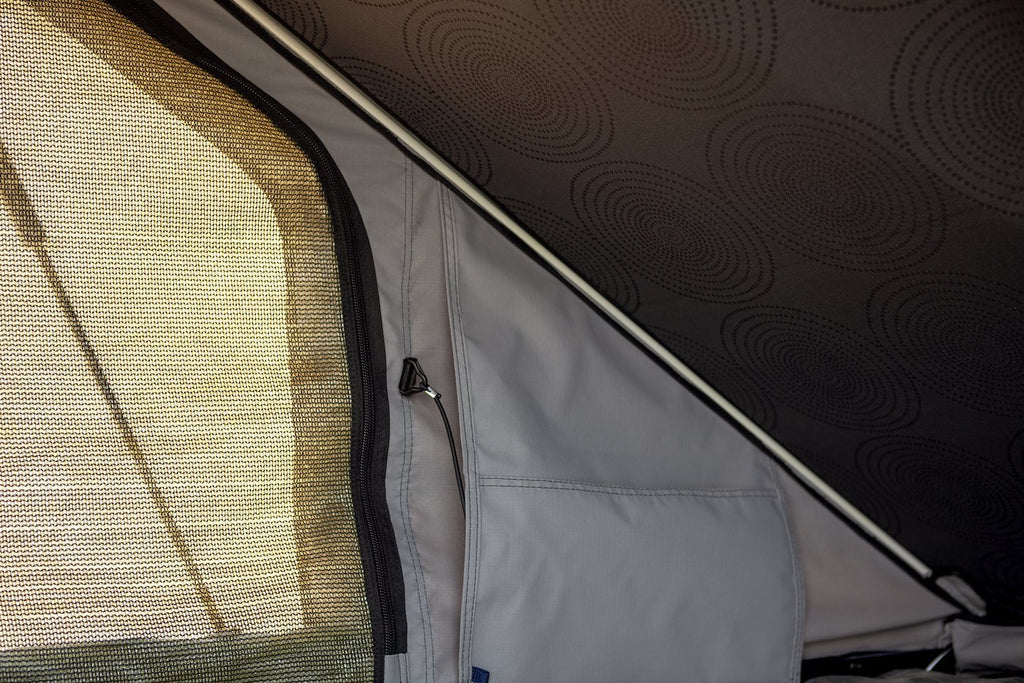inside view of the blade hard shell roof top tent by eezi-awn