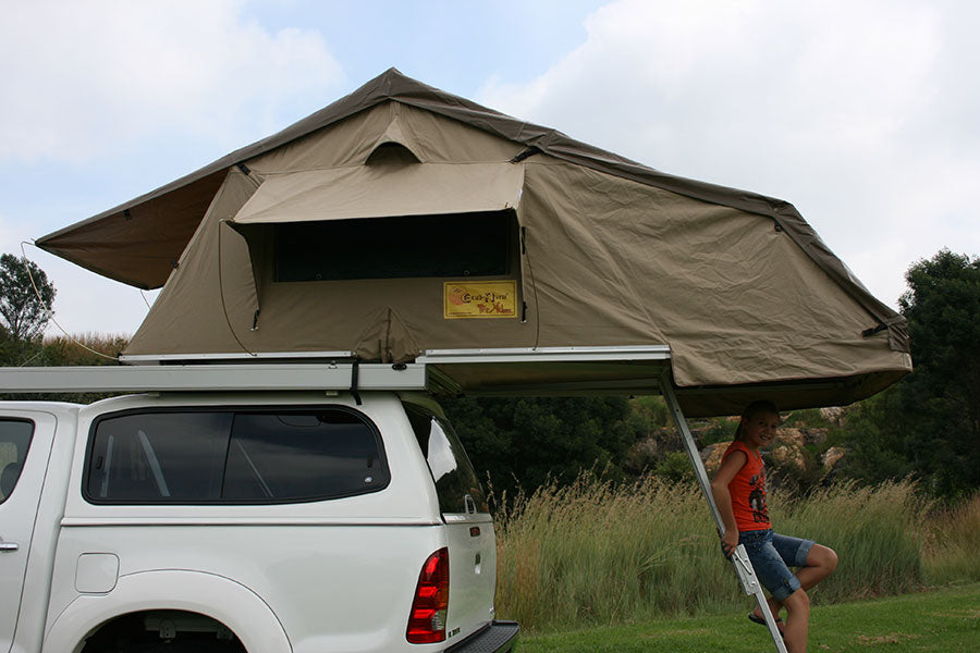 Eezi-Awn-T-Top-Xclusiv-Roof Top Tent Opening towards back of Hilux