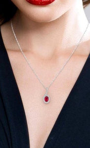 1/8 Ctw Oval Shape 6x4mm Ruby & Round Cut Diamond Precious Pendant in 10K White Gold