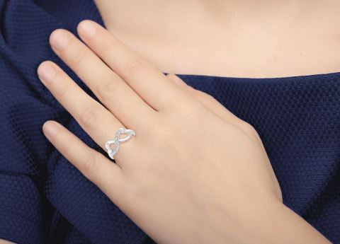 1/50 Ctw Single Cut Diamond Infinity Ring in Sterling Silver