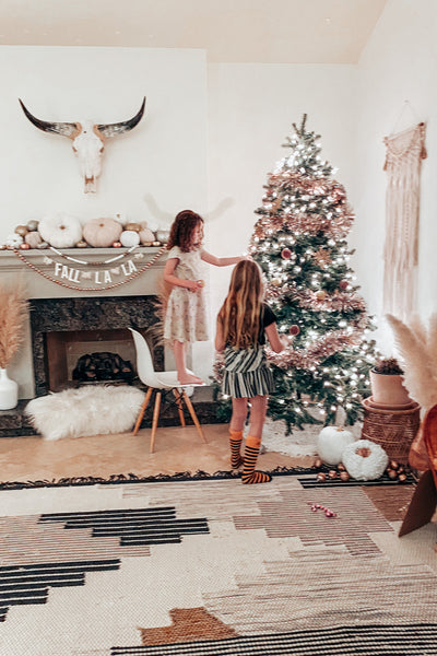 The kids decorating the christmas Tree