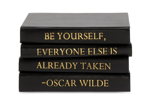 Stack of Black Leather Bound Books with Oscar Wilde Quote