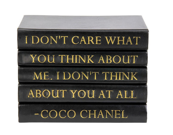 Stack of Black Leather Bound Books with Coco Chanel Quote