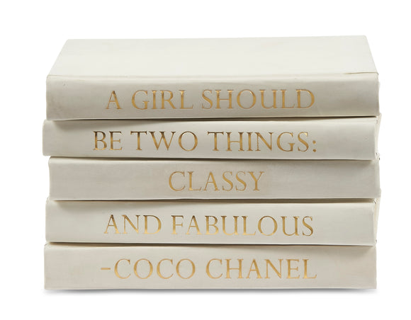 Stack of White Leather Bound Books with Coco Chanel Quote