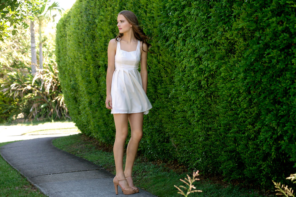 Model wearing Sweet Bow Ivory Spring Dress front view
