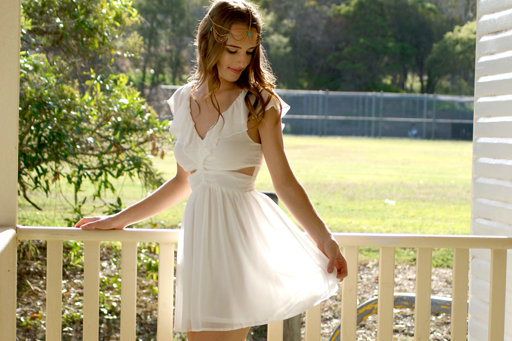 Model wearing Cutout Ruffles White Dress