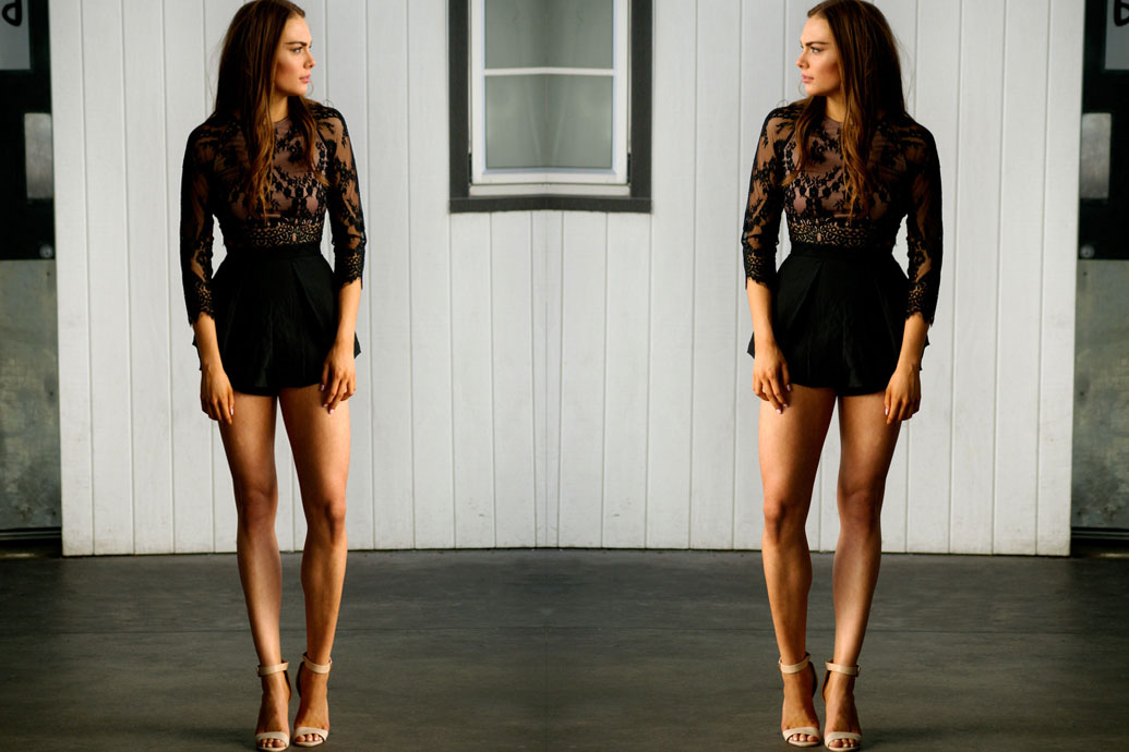 Mirror image of model wearing Leah Lace top with High waisted Black shorts