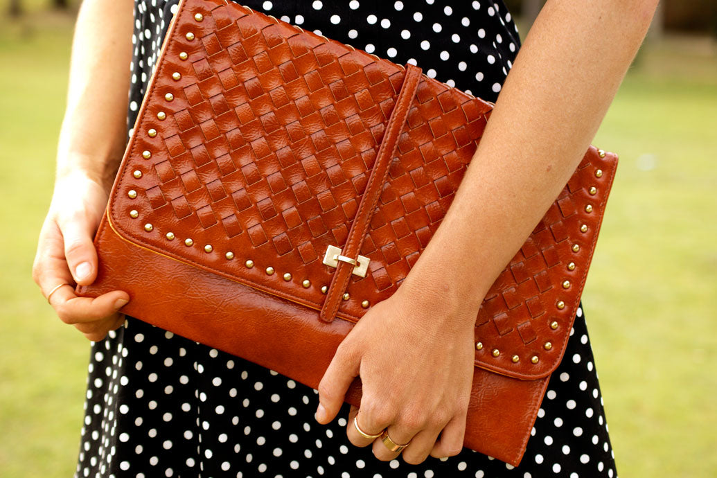 Close up of Brown leather clutch