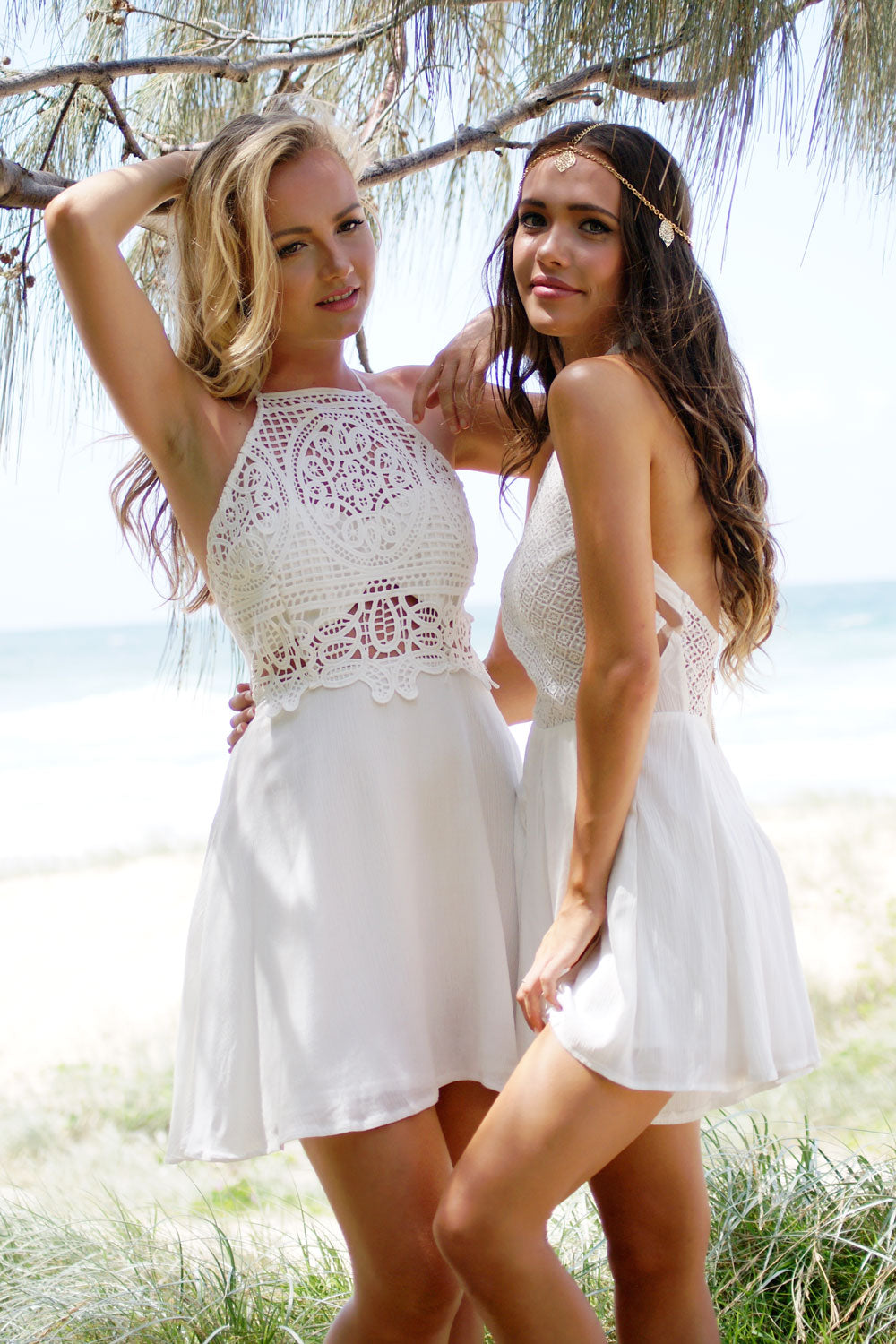 Two models standing together modelling white lace garments