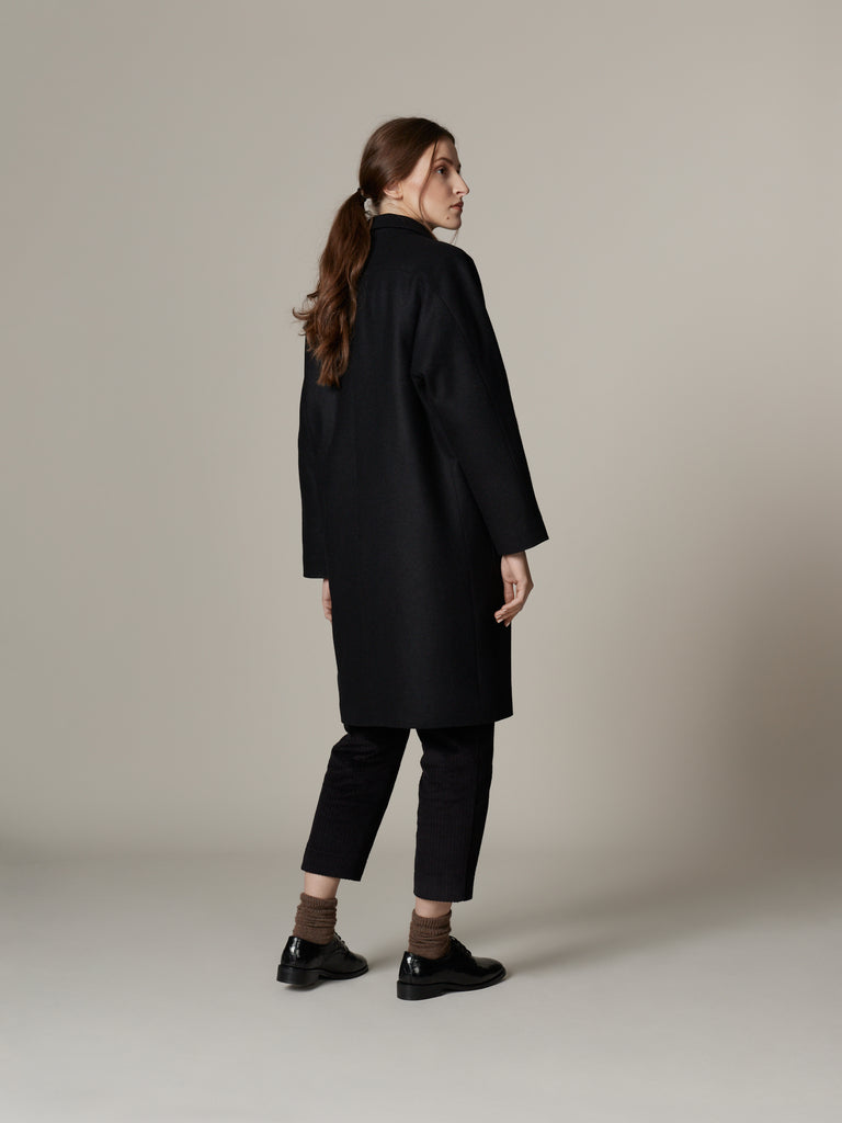 Outfit with minimalist black loden wool overcoat