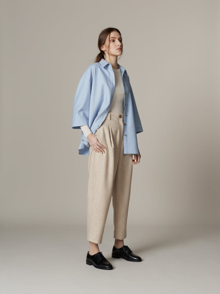 Relaxed minimalist wool outfit in soft pastel blue and beige