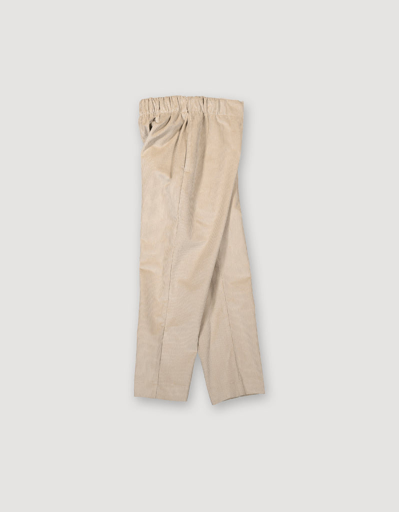 Beige comfortable pull on trousers made from heavyweight corduroy