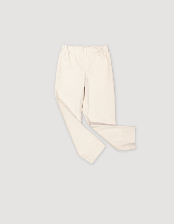 Sleek white cotton corduroy trousers with elastic waist and deep side pockets