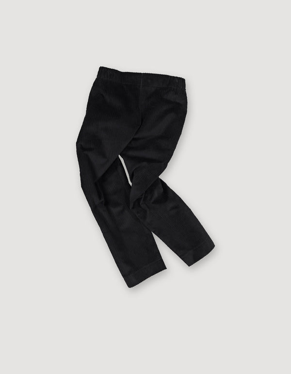 Sleek black cotton corduroy trousers with elastic waist and deep side pockets