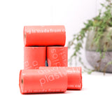 adios compostable dog poo loose roll bags in coral pink