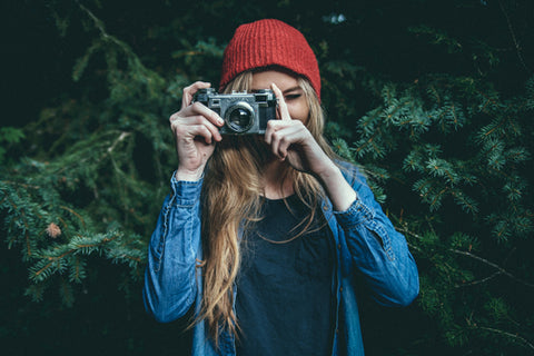 Woman with hair extensions taking a picture