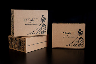 Prepaid coffee subscription. Three of our boxes, placed in different angles, showcasing traditional Guatemalan artwork.