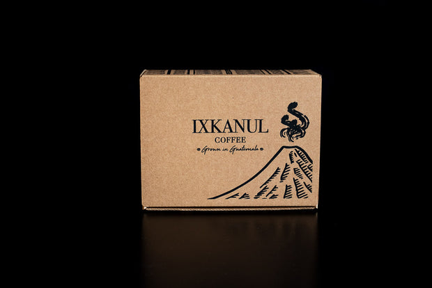 Single box of our coffee subscription. One of our subscription boxes, viewed from the front, displaying the volcano artwork.