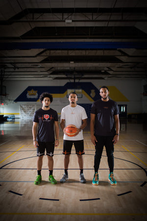 group basketball photo of: R to L, Jordan Persad, Jerron Rhodes, and Christian Casimier