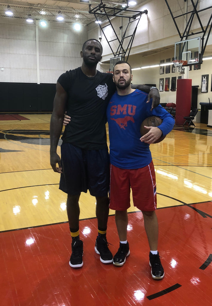 Filip Music standing with Patrick Patterson after basketball workout at Toronto Raptors facility
