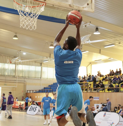 pro basketball player Kemel Archer rises for dunk
