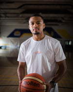 Load image into Gallery viewer, Jerron Rhodes wearing Love The Game Mentality's essential white basketball shirt