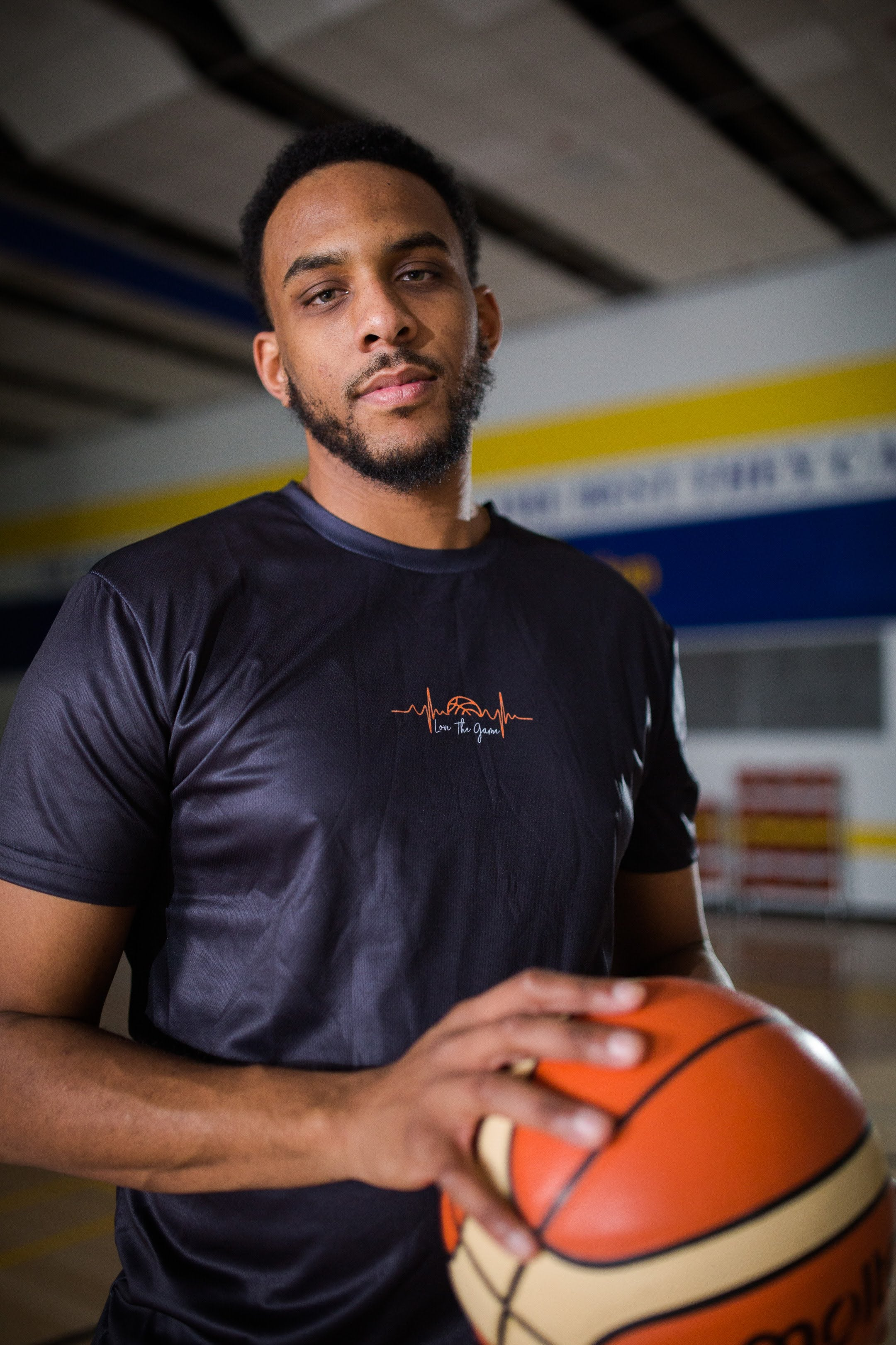 Christian Casimier wearing Love The Game mentality essential basketball shirt in black