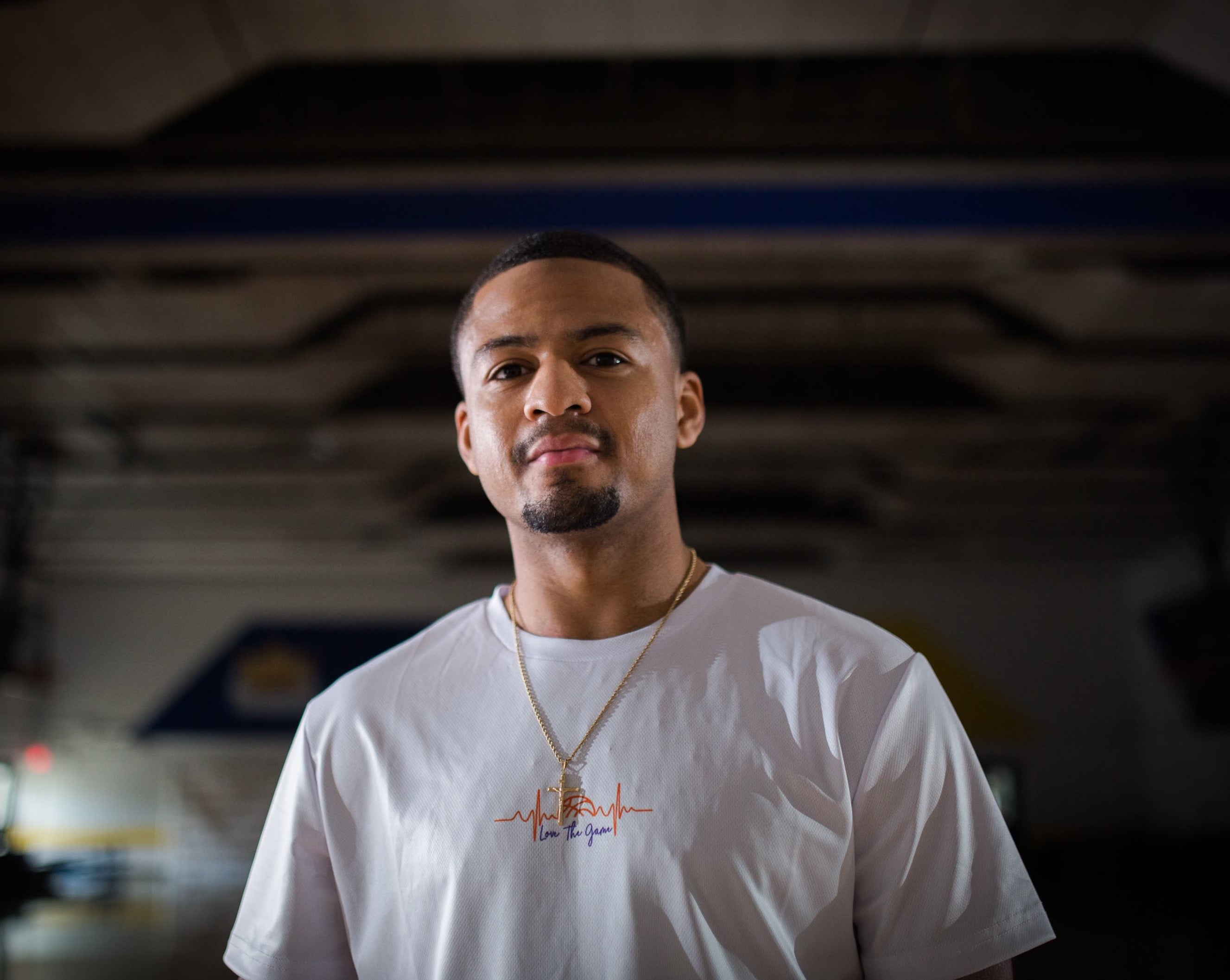 Jerron Rhodes wearing Love The Game Mentality's essential white basketball shirt