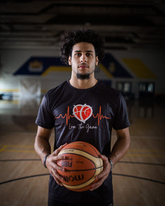 Basketball player Jordan Persad wearing Love and Basketball black shirt
