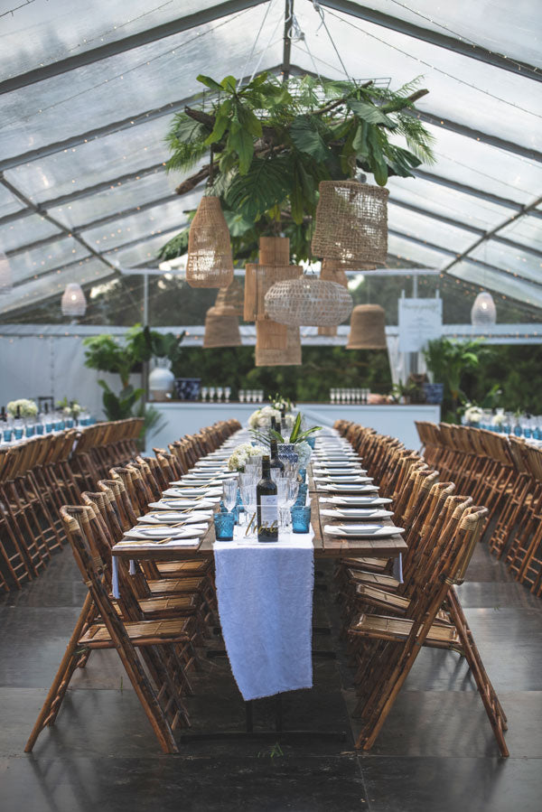 Hagning pendant lights and fake greenery was used to create a bahamas fell wedding - available for hire at the white place, orange nsw