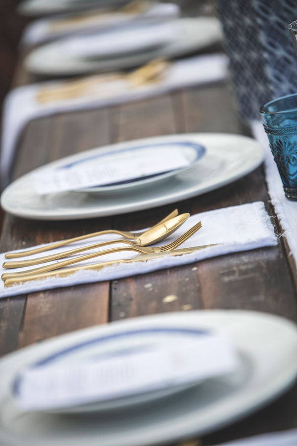 Gold cutlery, linen napkins, blue and white plates all available to hire in central west nsw