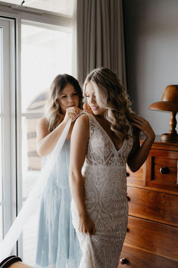 Emily and Bridesmaid fixing dress