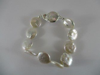 pearl bracelet - available at the white place, orange