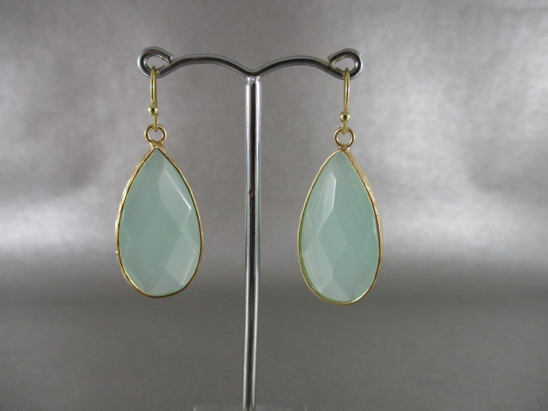 green and gold earrings - available at the white place, orange