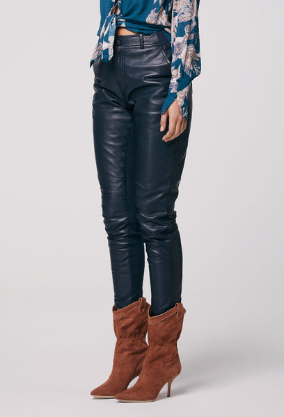 navy leather pants available at the white place, orange