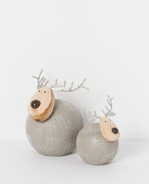 North Pole sitting reindeer silver