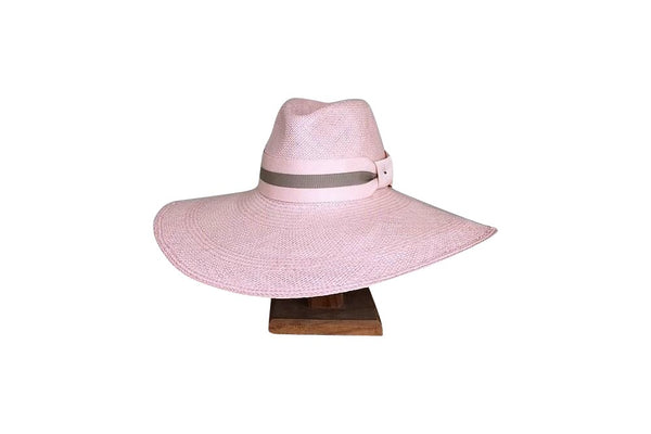 The 'Carolyn' Penelope Haddrill Hat is a Pale pink broad brimmed panama straw hat. Available for purchase at the white place, orange nsw