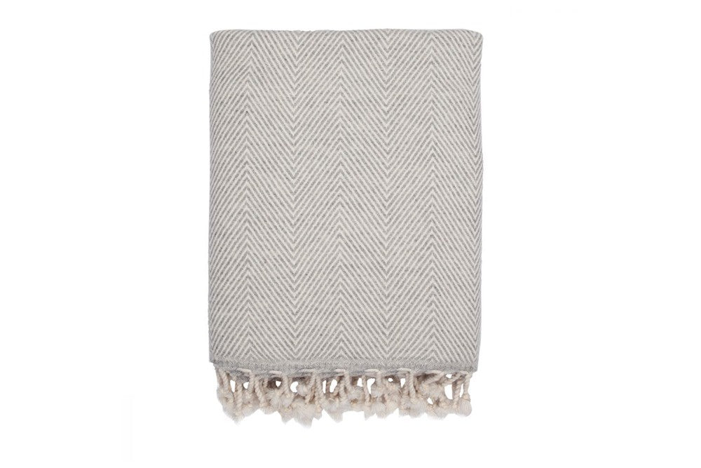 saarde herringbone lambswool throw in grey available at the white place