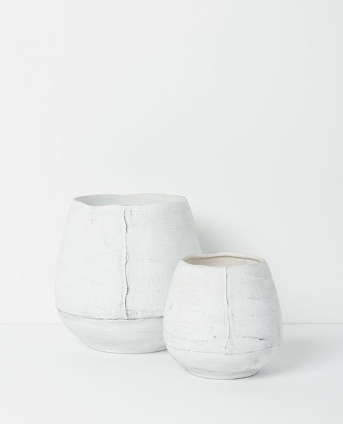 osona vases available at the white place, orange