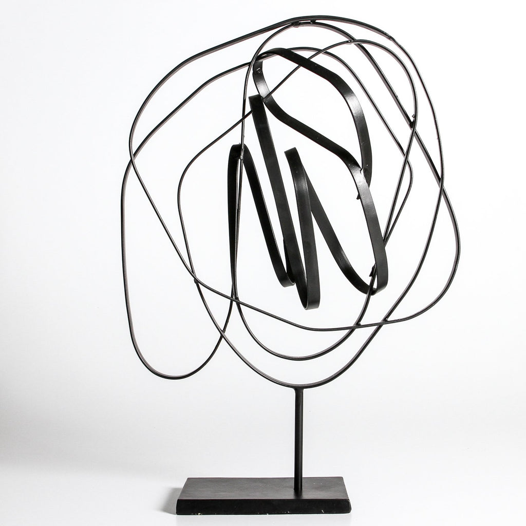 Abstract iron sculpture available at The White Place