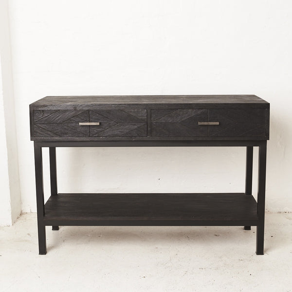 Inartisan Black Parquetry console available at the white place, orange