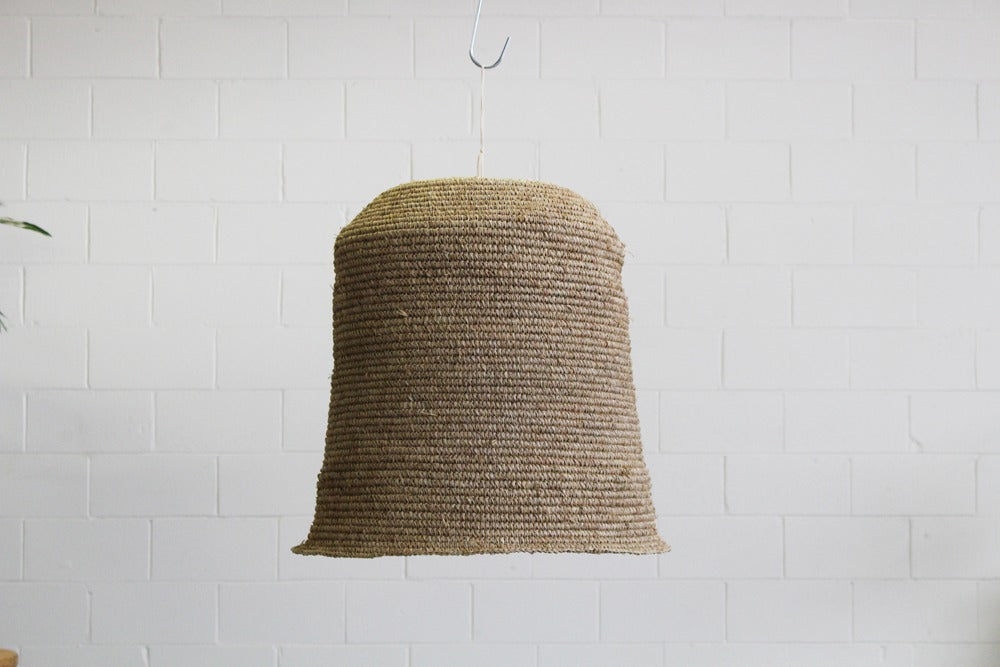 large woven seagrass pendant light to hire for events, parties, corporate bookings and weddings. hang opver a bar, service area or table setting for a dramatic look. available for hire in bathurst, orange, dubbo & central west nsw.