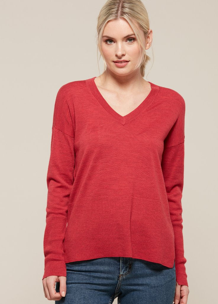 merino wool red v neck jumper from ella sanders, available at the white place, orange nsw.  free shipping within australia